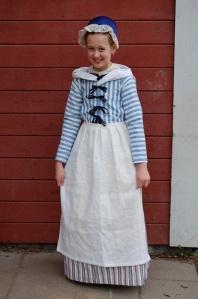 Flicka utklädd till Cajsa Warg.